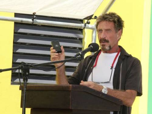 "Belize prime minister urges John McAfee to talk to police USA Today, Reuters: Calling John McAfee ""extremely paranoid"" and ""bonkers,"" the prime minister of Belize on Wednesday urged the 67-year-old antivirus pioneer to come out of hiding and talk to police about the weekend slaying of his American neighbor, Reuters says. Gregory Viant Faull, 52, was found dead Sunday with a gunshot wound to the back of his head in his home off the coast of Belize.  McAfee, whom police have called a ""person of interest,"" denies any involvement in Faull's death and says he is hiding because he fears that Belize authorities are trying to frame him. Photo: Software company founder John McAfee spoke last week at the official presentation of equipment ceremony that took place at the San Pedro Police Station in Belize. (Sofia Munoz / Ambergris Today Online / AP)"