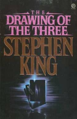 The Drawing of the Three, Stephen King (F, 20s, pearl earrings, grey scarf, bangs, G train) http://bit.ly/UHuCAC