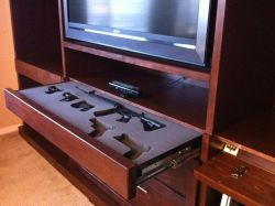 Hidden drawer gun safe in media center