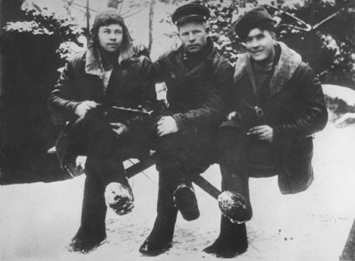 Three intelligence scouts of the Shish detachment of the Molotov partisan brigade pose outside in the snow. Pinsk, Belarus, circa 1942-1944. Photo by Faye Schulman, via the Holocaust Memorial Museum.