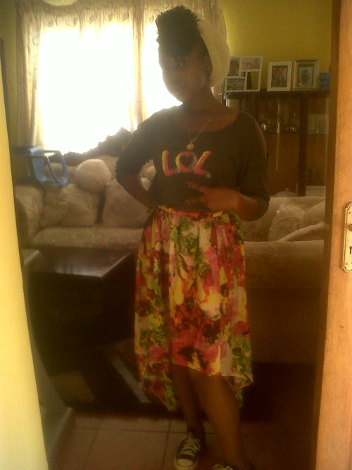 I just felt cute today and i got that Maxi skirt hmmmmmmmm i love!!!!goes nicely with the LOL tee that im rocking :). A skirt.beanie. all star. perfect.