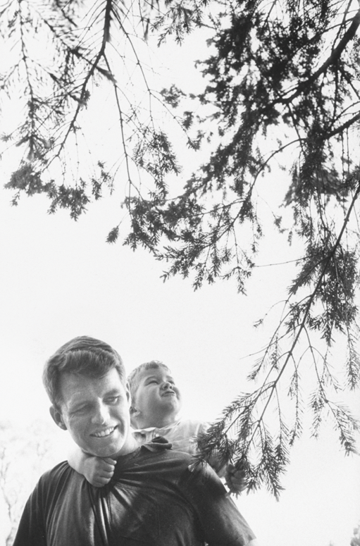 Robert F. Kennedy with Bobby Jr in 1957 in Town & Country December.