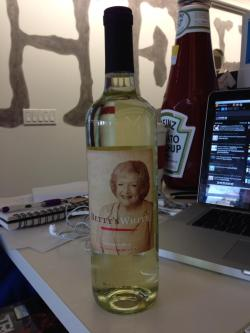 "popculturebrain:  huffposttv:  Well, this just arrived at my desk. Betty White Wine. GET IT!?!?! Also, yes that is a giant bottle of ketchup.  Obligatory/gross ""Betty's Pink"" joke."