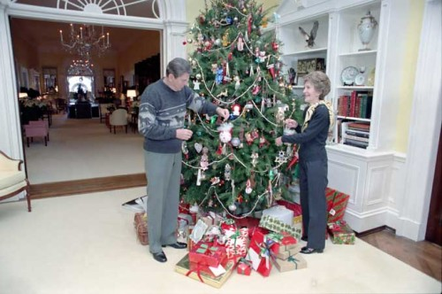 President Reagan and Nancy Reagan decorating the White House Residence Christmas tree. 12/24/83. -from the Reagan Library