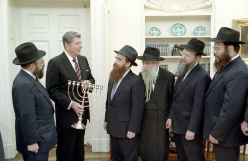 President Ronald Reagan receives a menorah from the Friends of Lubavitch in the Oval Office of the White House.  December 15, 1987. Two more nights of Hanukkah!
