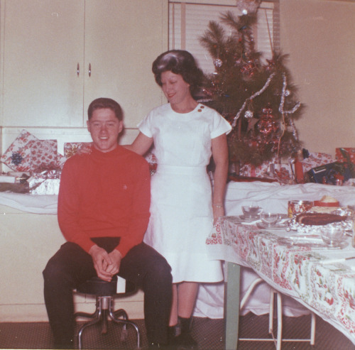 Bill Clinton and his mother Virginia Clinton at a Christmas Party. December, 1963.
