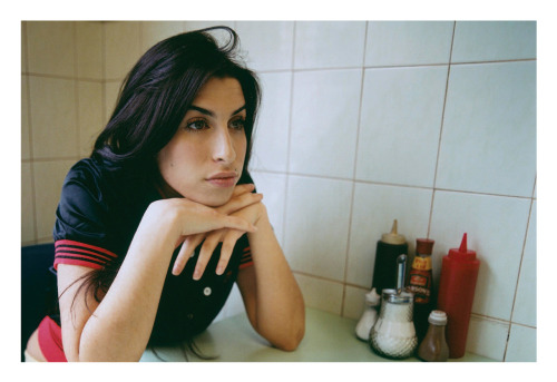 "Amy Winehouse photographed in London in 2004. These images appear in the booklet for the CD/DVD Box Set release ""Amy Winehouse at the BBC""."