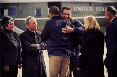 Cuomo hugging Obama as Bloomberg looks on, smiling. via @nygovcuomo