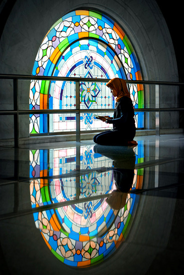 "stainedglassforever:  From the photographer, Rarindra Prakarsa: ""A woman reads Kor'an inside a Mosque in Jakarta.""  Reblogging because the photographer sent me some information about this gorgeous shot. Thanks!"