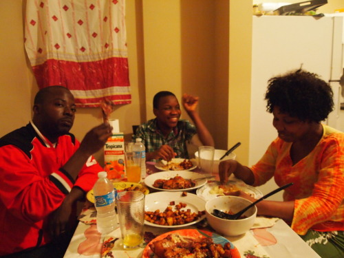 "Dinner with Rougi and Cisse, in the Bronx. My long, desperate search for a homemade African meal is over. As part of my ongoing ""Dinner With"" series, I finally scored an invitation to a West African household, just off Gun Hill Road, run by Rougiatou ""Rougi"" Tounkara and her husband, Cisse. Before immigrating, Rougi and Cisse lived the kind of lives that remind you just how ferocious racial bigotry is in some parts of the world. Even for Africans living in Africa. When he moved from the Ivory Coast to Tunisia, Cisse said he was spat on, by children, and had stones thrown at him, ""because I'm a black man."" ""They come close to you,"" said Rougi. ""They scream on you, they'll call you monkey. They call you dogs, they call you cats. But we never care."" But of course they did. Rougi was never allowed to go to school growing up, but she's making sure her kids get the best education possible, and they're blissfully unexposed to the sort of name-calling Rougi and Cisse once took for granted. So they're happy. The funny thing is, they're both unemployed at this point, getting by on whatever Rougi earns from sewing while Cisse looks for an IT job. Cisse moved here just a couple months ago, so they're in something of a honeymoon period. I wonder how long that'll last. But Rougi's hopeful. ""America is the best for me. I always say that, everywhere and every time. They help me a lot. To have all this opportunity."" On the menu: acheke (a grain, like couscous, but made of cassava — it's smoky and delicious), baked chicken (spiced with onion, garlic, and MAGGI cubes) and fried plantains. There was also a sauce, Sauce Tomate (ie., tomato sauce) that apparently included molten lava it was so hot. Many thanks to my warm and gracious hosts."