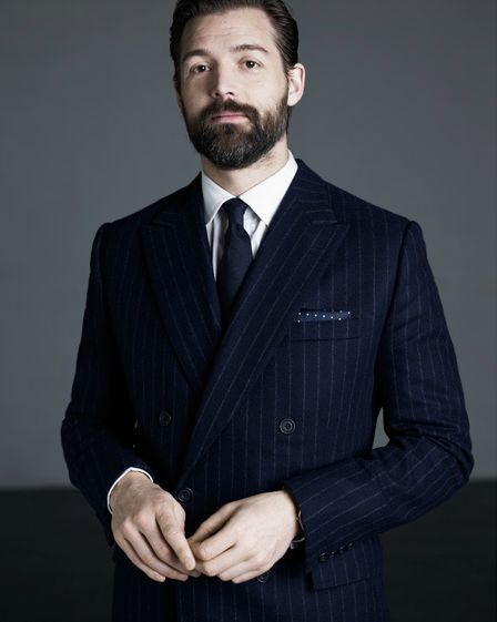amoderndandy:  gentlemanodd:  amoderndandy:  iqfashion:  Patrick Grant shot by Chris Floyd. Patrick Grant:  The men's shows in Italy have become a parade ground of idiotic über-preppiness taken to ridiculous extremes. There's a definite move back towards celebrating a simpler style of dress with focus on strong pieces, strong fabrics, not layers of jumble.  Source: ft.com - The preppy look is making way for menswear with a bohemian twist  I like this man's style, his dislike of Italian fashion and his beard.  Whilst his beard and dislike of Italian fashion are beyond reproach, and a double breasted suit is always a smart choice; I do believe he is wearing a black tie with a navy suit. And that is… regrettable.  Do you think that is a black tie? It looked navy blue to me, but maybe that's due to the lighting.   Nah that's definitely a navy tie.