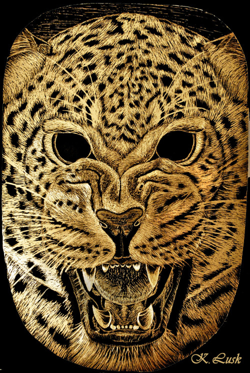 inspired-creations:  Rawr. by ~xWingless-Angelx Gold scratchboard-Animal mask assignment for media studies. Slightly distorted by the metallic base.