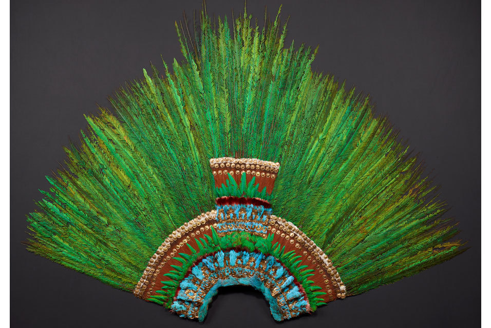 "Feather head-dress, Mexico, Aztec, early 16th century. Quetzal, Cotinga, roseate spoonbill, Piaya feathers; wood, fibres, Amate paper, cotton, gold, gilded brass  Between Myth and Truth Did this feather head-dress really belong to the legendary Aztec Emperor Moctezuma II? How, why and with whom did the ""Penacho"" come to Europe? Today, many myths and legends are still linked to this magnificent artifact. In 1519, when Spanish ships reached the shores of what is now Mexico, they encountered the thriving Aztec Empire. Initial contacts were friendly, but soon Hernán Cortéz and his conquistadores vanquished the empire and took Emperor Moctezuma II prisoner. Countless artifacts were sent to Europe. The most magnificent is the early Mexican feather head-dress known in Mexico as ""Penacho"". Called ""ain mörischer Huet"" (a Moorish hat), it was first mentioned in the inventory of the Armoury of Ferdinand II of Tyrol compiled in 1596 after the Archduke's death (Ambras Castle). During the Napoleonic Wars parts of the collection at Ambras were removed to Vienna, where they were displayed at Lower Belvedere Palace. This is where Ferdinand von Hochstetter discovered the feather head-dress and recognized its importance. He had the precious object restored before showcasing it at the k.k. Naturhistorisches Hofmuseum (Imperial Museum of Natural History). Together with the museum's other ethnographic holdings the feather headdress was eventually deposited in the Museum of Ethnology, opened in 1928. First identified as a ""mörischer Huet"" (a Moorish hat) in the late 16th century, the feather headdress was listed as an ""indianischer Huet"" (Indian hat) in later inventories; in 1788 it is called an ""indianische Schürze"" (Indian apron). This erroneous identification probably resulted from the loss of the original golden beak. This made it difficult to determine the object's original function and how it was worn. In 1855 the green feathers were identified as those of the Quetzal, which, in turn, pointed to Mexico as the artifact's country of origin. At the same time its original interpretation as a head-dress was once again accepted. Later, however, Ferdinand von Hochstetter suggested that it could have served as a standard from the time of Moctezuma. In the course of the Congress of Americanists held in 1908 in Vienna, an international commission ultimately accepted its identification as a feather head dress, which has remained scientific consensus until today. The early 20th century witnessed the first attempts to link the feather head-dress with Moctezuma himself. This sounded spectacular and enhanced the sensational fame of the artifact. The term ""featherwork crown of Moctezuma"" was first used in this context; it ignored the fact that rulers of the Aztec Empire were crowned with the Xiuhuitzolli, a tiara set with turquoises. Today, the ""Penacho"" is world-famous – celebrated not only as the last of its kind but also for the unrivalled iridescent splendor of hundreds of Quetzal feathers and its sumptuous gold appliqués. In the Penacho's Shadow A number of other 16th century featherwork artifacts have survived. Featherwork objects played a seminal role for the Aztecs, the Mayas, the Purépecha and their neighbours. They were used to denote the rank and status of princes, dignitaries, priests and successful warriors. The exhibition includes a number of examples in excellent condition.  I highly recommend reading Conquistador by Buddy Levy, possibly the best and most dramatic audiobook of all time."