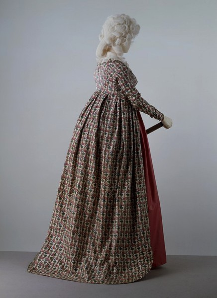 Robe, 1795-1800 England, the Victoria & Albert Museum  The cotton weaving and printing industries in Britain expanded greatly during the period 1775-1800. Cotton was a very popular fabric for clothing, from sheer muslins to heavy corduroys. It was part of the wardrobe of all classes. This printed cotton gown of the late 1790s could have been the Sunday best of a working-class woman or the informal morning gown of a wealthy lady. The very high waist and long sleeves are the typical fashion of this period.