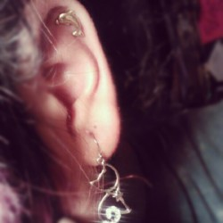 I got my cartlidge pierced :D #piercing #dolphin #cats #meow #ear #flyleaf #spotify #love