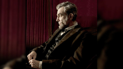 One of the best films of 2012, 'Lincoln' is a thrilling and exciting piece of American history The American political system is hopelessly fractured. Its legislators are viciously divided on how to govern the nation. The president, about to begin his second term in office on a groundswell of grassroots public support, is either too much or not enough of a pragmatist, depending on who you ask. He leans on his advisors when he needs to, but is driven by his fierce intelligence and intense determination to do what he feels is right; in this case, that's pushing through a country-changing bill through the House of Representatives, dominated loudly by his opposition. Still, he can deliver one hell of a speech when he needs to. Though it applies in many ways to President Barack Obama and the health care bill that's dominated Western culture for the last few years, this description is specific to the events of Steven Spielberg's new film Lincoln, about the final months of America's most beloved president. Parallels to the present day aside, Lincoln is an inspiring and thoroughly entertaining examination of how the political process worked nearly 150 years ago. CLICK HERE TO EXPAND THE ARTICLE