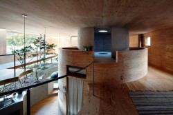 (via Pit House – Fubiz™) A wooden house designed around a central shaft, like a tree trunk. Wonderful.
