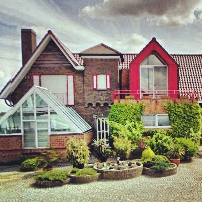 No need to choose a style in Belgium. You can use all of them in one house.
