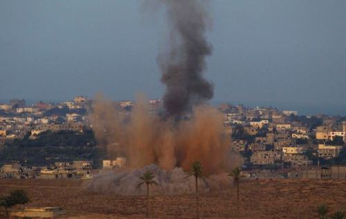 Smoke rises in the northern Gaza Strip after an Israeli strike. Violence may escalate between Israelis and Palestinian militants, with Friday's announcement that Israel has begun drafting 16,000 reserve troops. Credit: RONEN ZVULUN / REUTERS