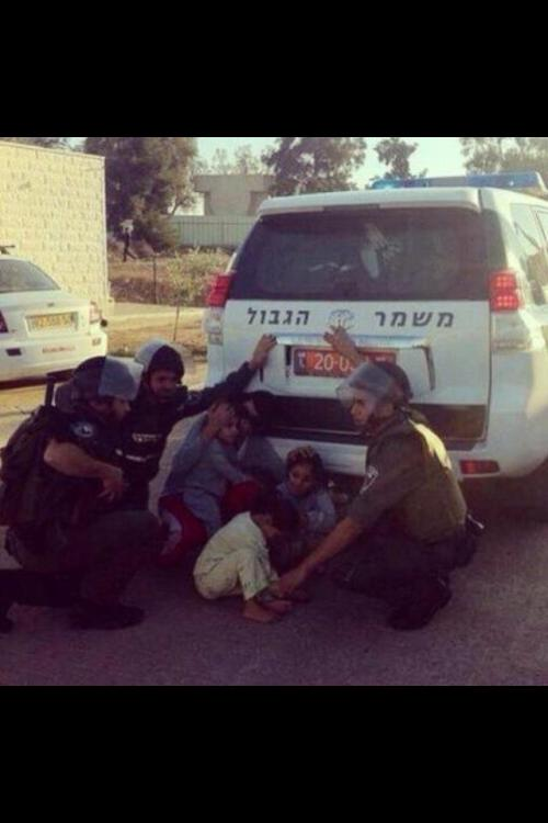The things you won't see on CNN or Fox. Israeli soldiers protecting Arab children.