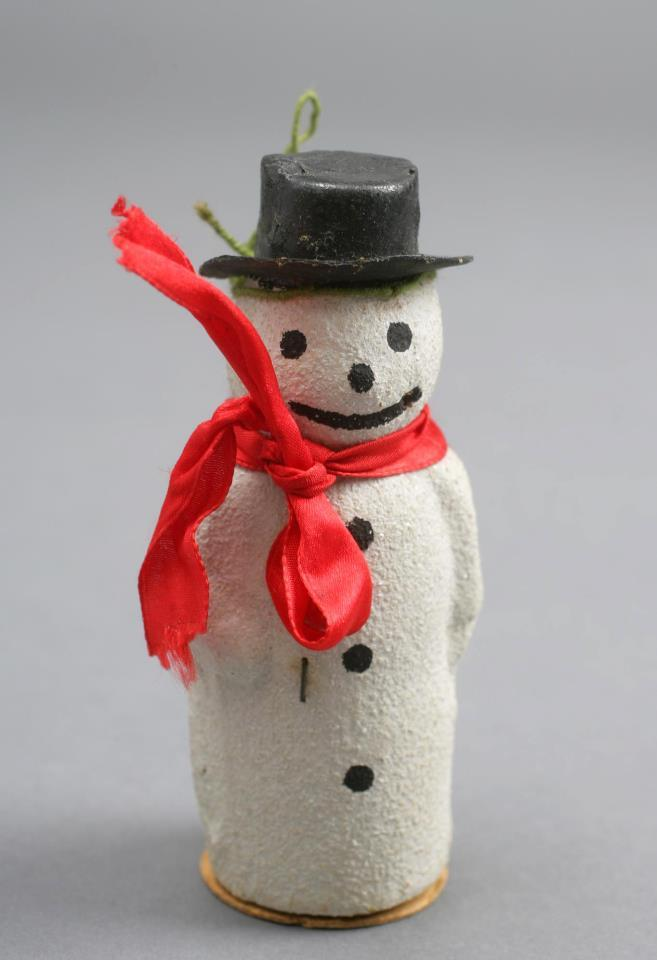 Image description: From the National Archives:  Truman's Snowman Christmas ornament that hung on Margaret Truman's first Christmas tree in 1924.  According to Margaret, this ornament was used year after year – along the way, this snowman lost his pipe.