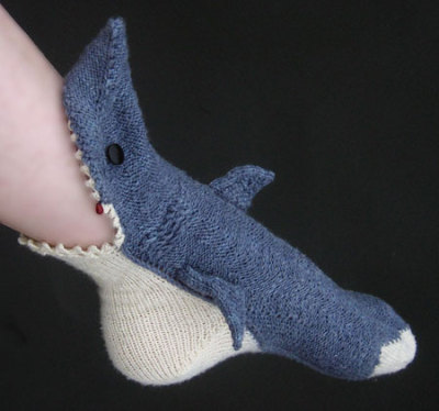 superslyskillzmcfly:  kathleenalice:  Shark Week socks by the Tsarina of Tsocks. I am in awe.  That is AWESOME.