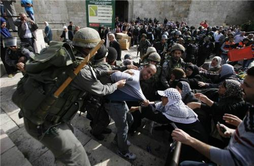 Israeli officers try to detain a Palestinian demonstrator after they clashed with Palestinians during a protest against Israel's military operation in Gaza, outside Damascus Gate in Jerusalem's Old City, November 16, 2012. (Reuters / Ammar Awad)