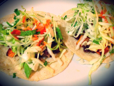 Black bean and sweet potato tacos Perfected with some tangy slaw, avocado, and hot sauce.