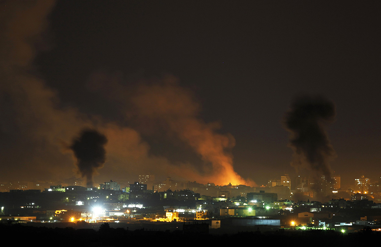 "From Rockets Over Israel and Gaza, one of 39 photos. Smoke rises after Israeli air strikes in the northern Gaza Strip, on November 14, 2012. Israel launched a major offensive against Palestinian militants in Gaza on Wednesday, killing the military commander of Hamas in an air strike and threatening an invasion of the enclave that the Islamist group vowed would ""open the gates of hell"". (Reuters/Darren Whiteside)"
