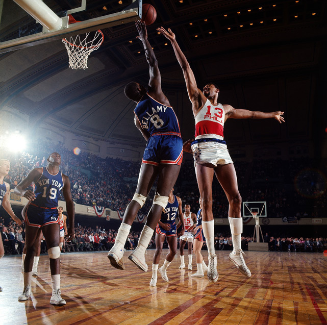 Walt Bellamy blocks a shot by Wilt Chamberlain during a 1966 Knicks-76ers game. (Neil Leifer/SI) GALLERY: Classic Photos of Wilt Chamberlain | Iconic Knicks Photos