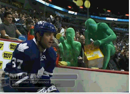 Green Men Throw Waffles at Hockey Player [Click to animate]