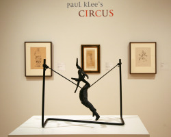 "Paul Klee's Circus presents a selection of works featuring acrobats, jugglers, clowns, and buffoons. Come dodge the rain TODAY w/ food + fun at our Pop-Up Lunch inspired by the exhibition! We'll be in the Schwab room from 11:30am-1:30p, where sliders by Straw SF and cotton candy by Blue Bottle will be for sale :) Image: ""Paul Klee's Circus"" installation view featuring Alexander Calder's ""Tightrope Walker,"" 1944."