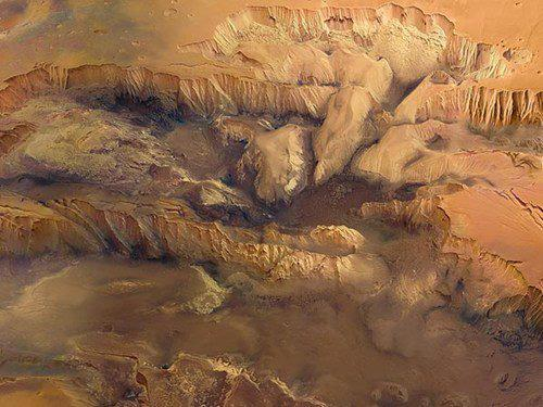 This is a false-color composite image of Valles Marineris, Planet Mars' very own Grand Canyon, captured by the High Resolution Stereo Camera (HRSC) aboard ESA's Mars Express spacecraft. Stretching across the Martian highlands for 2,485 miles (4,000 kilometers) in length, 124 miles wide and up to 6.8 miles deep, Valles Marineris is considered one of the largest known canyon systems in the solar system.