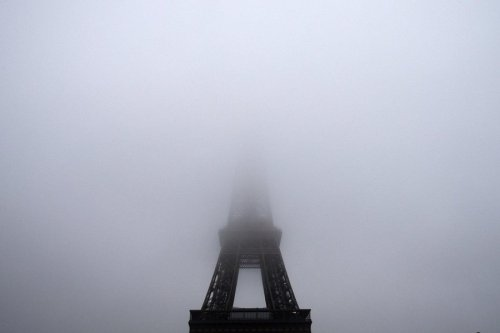 newsflick:  Eiffel Tower disappears on foggy Parisian day [Joel Saget / AFP - Getty Images]