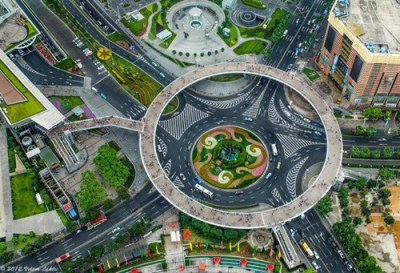 thedailywhat:  Nice Structure of the Day:  In the heart of Shanghai's hustle-and-bustly Lujiazui financial district lies a circular elevated walkway that serves as a pedestrian overpass and an observational deck. For more bird's eye views of the landmark, head over to Google Maps. Photographed by Victor Lakics from the Oriental Pearl Tower.
