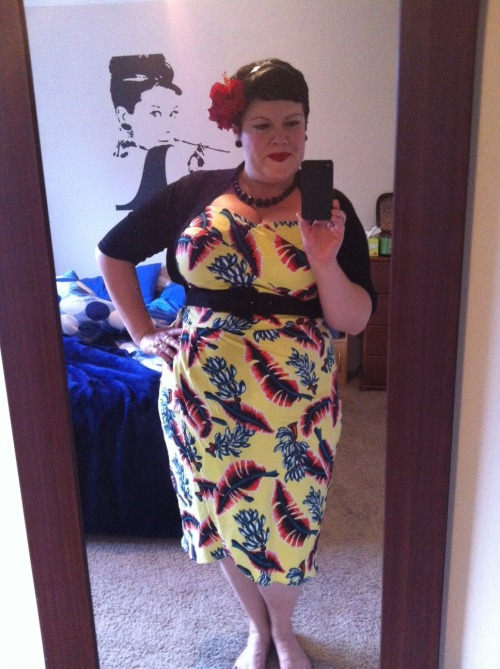 ilikeprettyclothes:  What I wore last night - feelin' tropical. My new hair flower is lovely and realistic smelling, but the large clip it's attached to will not stay in my short hair. So I had to wear a headband with it so that it had something to slip on to. Not ideal, but it will have to do. dress and belt - Pinup Girl Clothing, shrug - City Chic, necklace - Walmart, earrings - Domino Dollhouse, hair flower - Uncle Fezter, headband - The Warehouse, I also added my black kitten heels from Number 1 Shoes