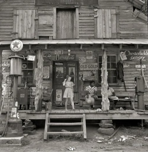 "smartchickscommune:  Country Store: 1939 July 1939. ""Daughter of white tobacco sharecropper at country store. Person County, North Carolina."" The rustic emporium seen earlier here and here. Medium-format nitrate negative by Dorothea Lange. View full size."