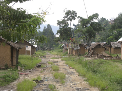 "Photo: Looted and burned houses in Pinga after fighting between armed groups caused the majority of the town's population—together with many of MSF's Congolese staff—to flee the area in October. DRC 2012 © MSF Violence in North Kivu, DRC, Displaces Thousands, Forces Majority of MSF Personnel to Evacuate Active fighting has hit the town of Pinga in the North Kivu Province of the Democratic Republic of Congo (DRC) once again, forcing 20,000 inhabitants and the majority of Congolese personnel employed by MSF to flee for the second time in six weeks. Armed groups have clashed in the last few days, causing widespread panic and alarm in the area. Fearing for their lives, people grabbed whatever they could carry and ran into the surrounding forests. While displaced from their homes and villages, people's access to health care is extremely limited. Some of those wounded in the fighting were brought to the MSF-run hospital 50 kilometers [about 31 miles] away in Mweso where doctors treated 24 people for violent trauma. Twelve more managed to reach the Mpeti health center 18 kilometers [about 11 miles] away from Pinga. ""What we see in Pinga is the tip of the iceberg,"" said Grace Tang, MSF head of mission. ""This kind of violence and mass displacement is happening throughout the province of North Kivu. We're trying to respond as best we can in very difficult and challenging circumstances."""