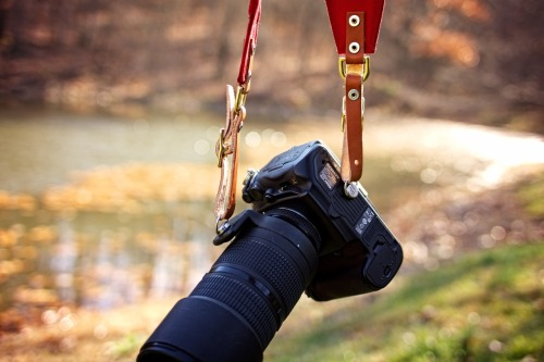 The RuckStrap in red paired with @Belstaff jacket carrying the Nikon D700 & 80-200 2.8 lens. By using two HoldFasts combined with the strap it makes an exceptional way to carry a larger lens for fast access and all day comfort. The strap that holds everything, including the camera. Hand made in the United States. More info here.