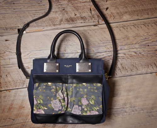 Just hit shelves: Rag & Bone's floral Pilot bag is equal parts girly and rugged. Small Pilot - Navy Floral, $755, rag-bone.com