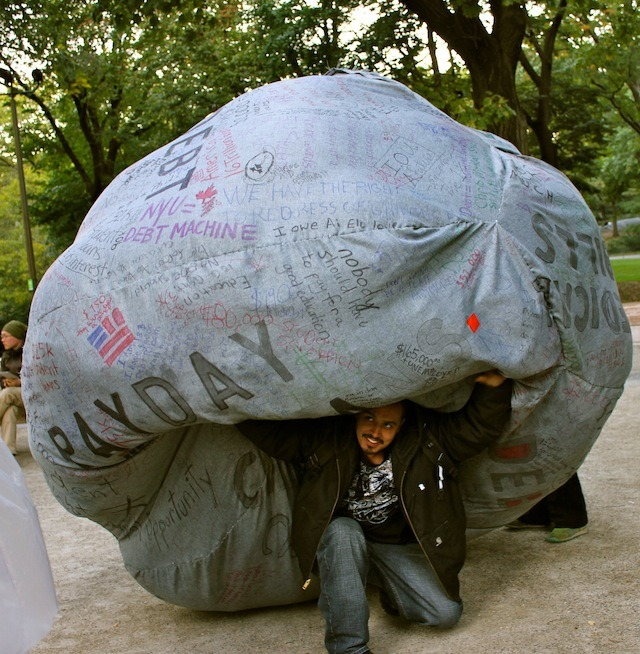 "Occupy's Rolling Jubilee Wants to Give Americans Money for Nothing Walking the streets of New York City this spring, you would have been hard-pressed not to come across posters promoting the Occupy Wall Street-led May Day general strike. ""A day without the 99 percent,"" is how it was billed. With the strike, the group was attempting to light a fire that might bring down capitalism and launch the US into an American Spring. However, Occupy's rallying cry fell on deaf ears, as the rally had poor attendance and limited impact. Looking back, it seems like that was the moment that the pied pipers of political and economic discontent's critical mass finally dissipated. The group's momentum seemed to have run its course, and the fickle media's attention turned to the sideshow that was the 2012 presidential election. After May Day, Occupy had to find itself all over again. Call it an identity crisis. But in an organization as decentralized as OWS, where individual efforts and actions are constantly emerging as branches and nodes of a shape-shifting whole, identity is a fluid concept anyway. The post-May Day breakdown was a chance for rebirth—a function of Occupy Wall Street's built-in eternal recurrence mechanism. It was in this ferment that Occupy forged its next project: Rolling Jubilee, a plan to buy anonymous medical debt, thus offering relief to Americans burdened by exorbitant healthcare costs. ""From the very beginning of Occupy Wall Street, the question of crippling debt that people are forced to carry has always been part of the agenda,"" says Yates McKee, a member of Occupy's Strike Debt team, which is leading the Rolling Jubilee project. ""Student debt, mortgage debt, medical debt, and municipal debt—all of that has been a part of Occupy from the very beginning."" Activists within Occupy Student Debt, an early sub-group of Occupy focused on the debt crisis, had the idea of using Occupy's I Am The 99 Percent Tumblr to present real people who were debtors and break the silence around debt. It was a issue that was close to their hearts, as  many of the original Occupy campers were debtors of all stripes. As Yates explains it, Occupy Student Debt went on to create the Pledge of Refusal, which many Occupy participants signed. ""It wasn't about forgiveness,"" Yates emphasizes. ""It didn't say, 'Let's come up with a piece of legislation that forgives our debt.' Rather, it noted that going into debt is systematic. In order to live, you have to enter into this predatory debt. So the Pledge of Refusal was non-compliant with the debt system. It was similar to a debt strike."" Originally, the debt strike concept gained a lot of traction within the Occupy movement, but people across the country weren't ready for such an idea and conditions across the country couldn't support a mass default. So in the post-May Day void, where Occupy's idealism finally gave way to reality, they knew they had to take another approach to fighting debt. Luckily, the Occupy Student Debt movement still had a great deal of enthusiasm behind it, even after May Day. ""The only campaign that still had a lot of energy was the Occupy Student Debt campaign,"" observes Yates. ""So over the summer, we decided to have what we call 'thematic assemblies,' where in one assembly we talked about the environment, and in another assembly we talked about labor. And then we did one on debt. And we made sure to invite everyone from Occupy Student Debt, Occupy Universities, Free University, and Occupy Labor."" The larger assembly then got together and discussed what would it mean to build a political movement around debt in all its forms and not just on certain types of debt in isolation, like student loans. This ultimately lead to the transformation of Occupy Student Debt into Strike Debt, the sub-group which now healms the Rolling Jubilee. ""One phrase we started to use was 'Debt is the tie that binds the 99 percent'"" says Yates. ""There is something structural about the debt economy we're forced to go into in our lives. And this was when we flipped the idea of a debt strike to Strike Debt. What would it mean to strike debt, to attack debt from all these different angles and metaphorically cross it out?"" Occupy describes the vast swaths of America's debtors as ""an invisible army of defaulters."" What if this invisible army were to come out of the shadows and become a political force? Out of this thought experiment came debt memes like ""You are not alone"" and ultimately the Rolling Jubilee program. Jubilee, as laid out in the Bible's book of Leviticus, was a time when debts were forgiven. Strike Debt appropriated the concept in a symbolic way and used it as the namesake for its first major project, in which a fund—financed by donations—buys debt. Continue"