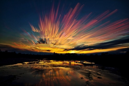"trevoycana:  showslow:  Ontario, Canada-based photographer Matt Molloy recently created a gorgeous series of sky images by stacking multiple photos onto one. The individual photos are most often taken from the timelapses he shoots. The final photo has a stunning painterly effect, almost as if someone had taken a paintbrush to the sky and smeared its beautiful colors. When asked at 500px how many photos it took to create the one seen above, he replied, ""I'm not exactly sure, but I used hundreds of photos to create this one image."" (Via).  Probably one of the most amazing things I've ever seen. Just wow."