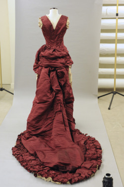 """This satin dress, made in Paris, was worn by Emily Cutts Judd to the coronation ball for King David Kalakaua on Feb. 12, 1883."""