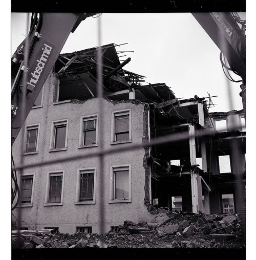 Deconstruction on Flickr.LOMO LUBITEL 166U - ILFORD HP5 (by maxwellmaxen on Lomography) The next shot from my review. I have always been fascinated with deconstruction and tearing down of buildings. This special one has a certain meaning for me. My mother worked a long time in the building next to it and so i've seen this on at least a weekly basis, because i went to visit the newsroom she worked in at least once a week. I loved how it smelled there, how everyone worked, how something new got made on a daily basis. Right now they are building amazing new housing there, so to the win of a tearing down picture, i also got new nice buildings instead of old ones.