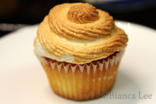 Lemon Meringue Cupcakes Makes 12 1c flour 1tsp baking powder pinch salt 75g butter 2/3c sugar 1 1/3 egg 1.5tbsp lemon zest 2tsp lemon juice 1/3tsp vanilla 1/3c milk Curd: 1 egg lightly whisked 50g butter 2tsp lemon zest 1/4c lemon juice 1/2c sugar 180C. Beat butter and egg until creamy. Add eggs, vanilla, zest. Add flour mixture in three batches, alternating with 2 additions of milk and lemon uice. Divide among cupcake liners. Fill to THREE QUARTERS FULL (seriously) Bake for 25 minutes. CURD: Combine egg, butter, lemon zest, juice, and sugar in saucepan. Cook at low heat and stir for 5 minutes until boil and thicken. (if u think its too sour add some milk- it'll still thicken later, just mix it in) Remove from heat, strain through sieve. Cover with cling wrap, make sure cling wrap touches surface of  curd to prevent skin forming. Put in fridge to cool and thicken MERINGUE: 3 egg whites some sugar, 1/4 tsp cream of tartar Beat egg whites until foamy, add cream of tartar. Beat more, add sugar, beat until stiff peaks (super glossy). If you over beat it'll look really foamy again. YOU DONT WANT THAT. Put meringue in piping bag with a nozzle (or no nozzle, u choose) Assembling cupcakes: Use knife to cut small hole out of cupcake surface (on top). FIll hole with lemon curd (that has been thickened, left in fridge for a while) to the top. Then use some crumbs to sprinkle on top of curd to kinda cover it.  Pipe meringue on top. Afterwards you can either put it in an oven that is heated for approx 5 minutes until meringue slightly golden brown, with lots of white colour of the meringue showing. I used 180C, u can use higher temperature, but just make sure you take them out earlier.