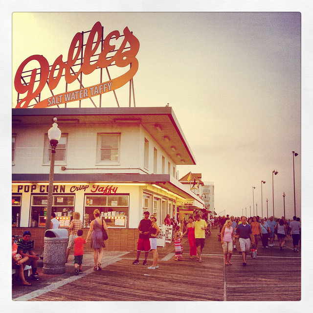 americanguide:  Rehoboth Beach, Delaware, on the boardwalk in the summertime. Some #AmericanGuideWeek friendly advice: Try the salt water taffy. * * * Photo by David Kozlowski. Find him on Tumblr (dfwphoto) and Flickr.