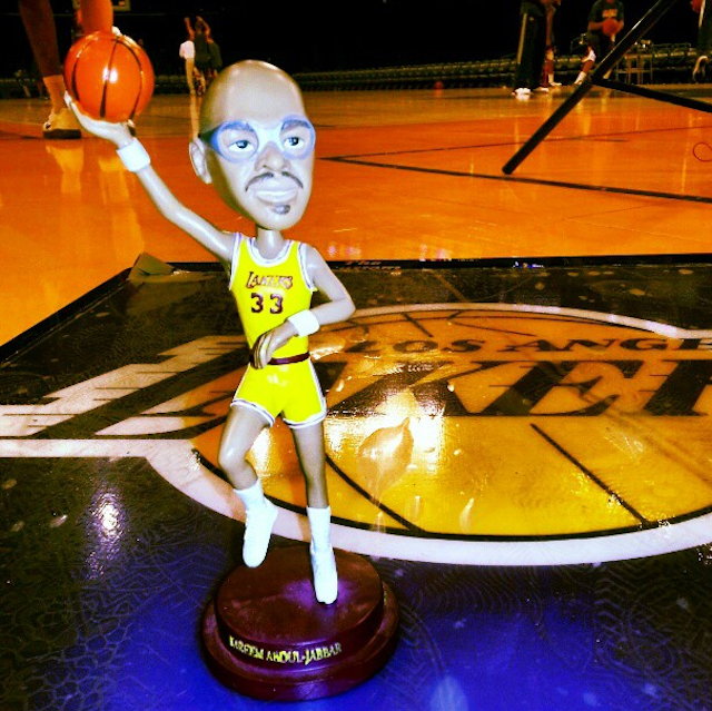 thetickr:  Check out the Kareem Abdul-Jabbar bobblehead Lakers fans got Friday night. That skyhook still lookin' tight. (via @DuranSports) Good for KAJ. Look at this guy with his statue.