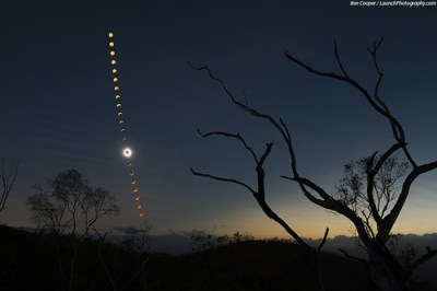 thedailywhat:  A Rare Total Solar Eclipse Takes Over the Night Skies in Australia  Photographed by former NASA photographer Ben Cooper in Queensland, Australia.