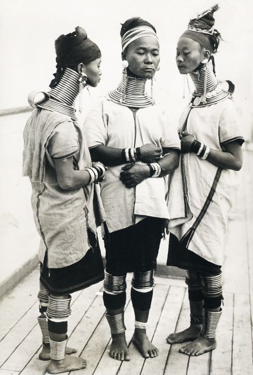 Three Burmese women,members of a circus, wear the brass neck and leg rings traditionally worn by Padaung women since childhood and which cannot be removed, New York c. 1930's
