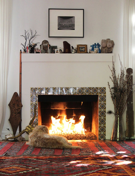 Cozy up by the fireplace.